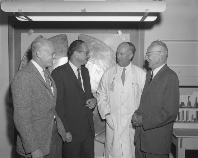 "Shutdown of 60-inch cyclotron at Crocker Lab. Left to right: Bob Thornton, Ed McMillan, John Lawrence, and Donald Cooksey. Photo taken 6/22/1962. 60""-618. Principal Investigator/Project: Crocker Lab/60-inch"