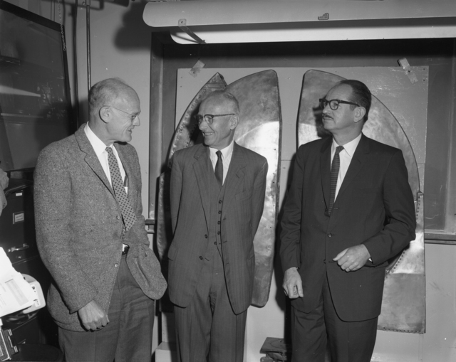 """Shutdown of 60-inch cyclotron. Left to right: Bob Thornton, Donald Cooksey, Ed McMillan standing in front of """"Dees"""". Photo taken 6/22/1962. 60""""-622. Principal Investigator/Project: Crocker Lab/60-inch"""