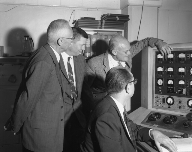 """Shutdown of 60-inch cyclotron. Left to right: Donald Cooksey, unknown individual, Bob Thornton, and Ed McMillan at control panel. Photo taken 6/22/1962. 60""""-624. Principal Investigator/Project: Crocker Lab/60-inch"""