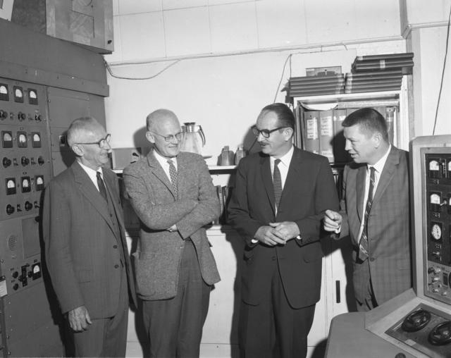 "Shutdown of Crocker's 60-inch cyclotron. Left to right: Donald Cooksey, Bob Thornton, Ed McMillan, and unidentified individual. Photo taken 6/22/1962. 60""-611. Principal Investigator/Project: Crocker Lab/60-inch"