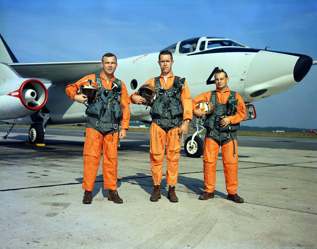 The crew of an RA-3B Skywarrior aircraft prepares to depart on a mission in the Caribbean. The men, from Light Photographic Squadron 62 (VFP-62), are from left to right: Lieutenant (LT) Herbert Nichols, pilot; LT Rodney Jenkins, navigator; and PH1 Jack D Carter, photographic technician