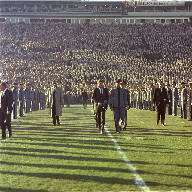 President Kennedy is Escorted across the Field by an Unidentified Cadet and General Clifton during Halftime of the Army-Navy Football Game, Philadelphia Municipal Stadium