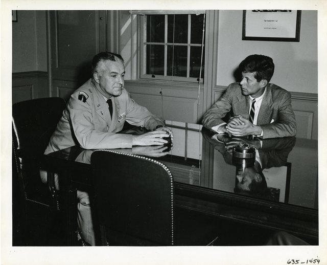 Senator John F. Kennedy Meets with an Officer at the Watertown Arsenal