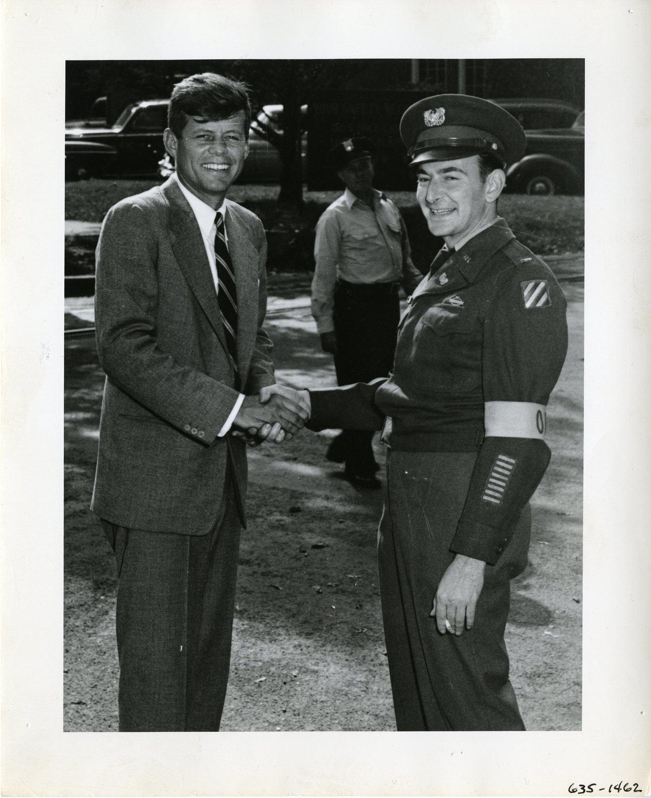 Senator John F. Kennedy Shakes Hands with an Officer at the Watertown Arsenal