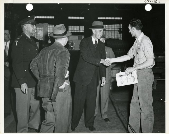 Senator Leverett Saltonstall Meets with an Officer and Workers at the Watertown Arsenal