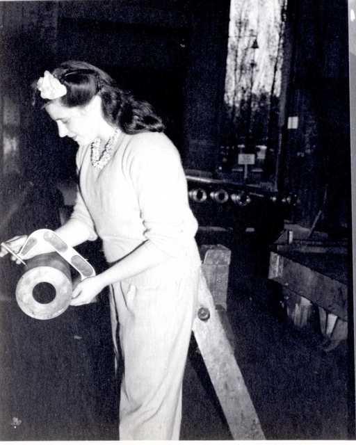 Woman Measuring Artillery Barrel