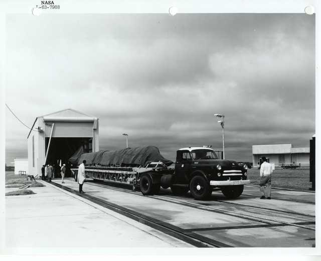 Photograph of a Truck Transporting a Rocket that is Covered by a Tarp