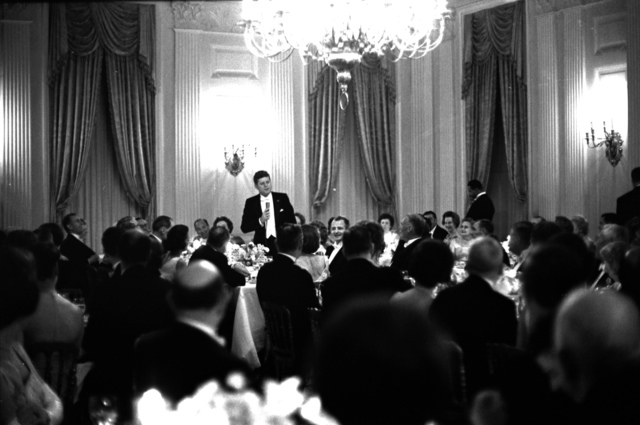 President John F. Kennedy Speaks during the Dinner in Honor of the Vice President Lyndon B. Johnson (LBJ), Speaker of the House John W. McCormack, and Chief Justice of the United States Earl Warren