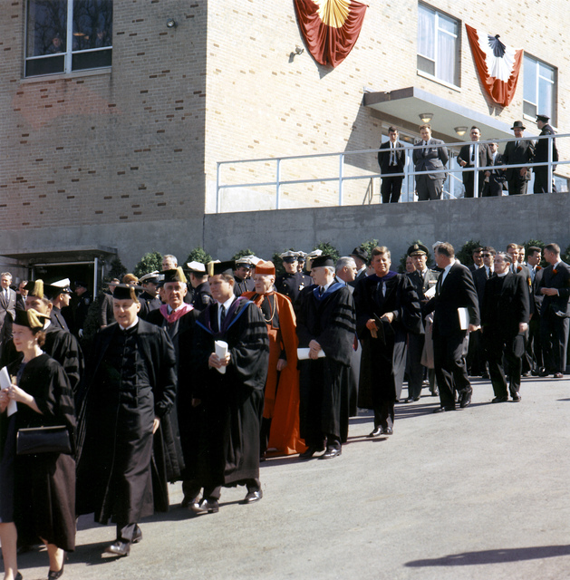 President John F. Kennedy on the Campus of Boston College for Centennial Ceremonies, Proceeding from Roberts Center to Alumni Stadium