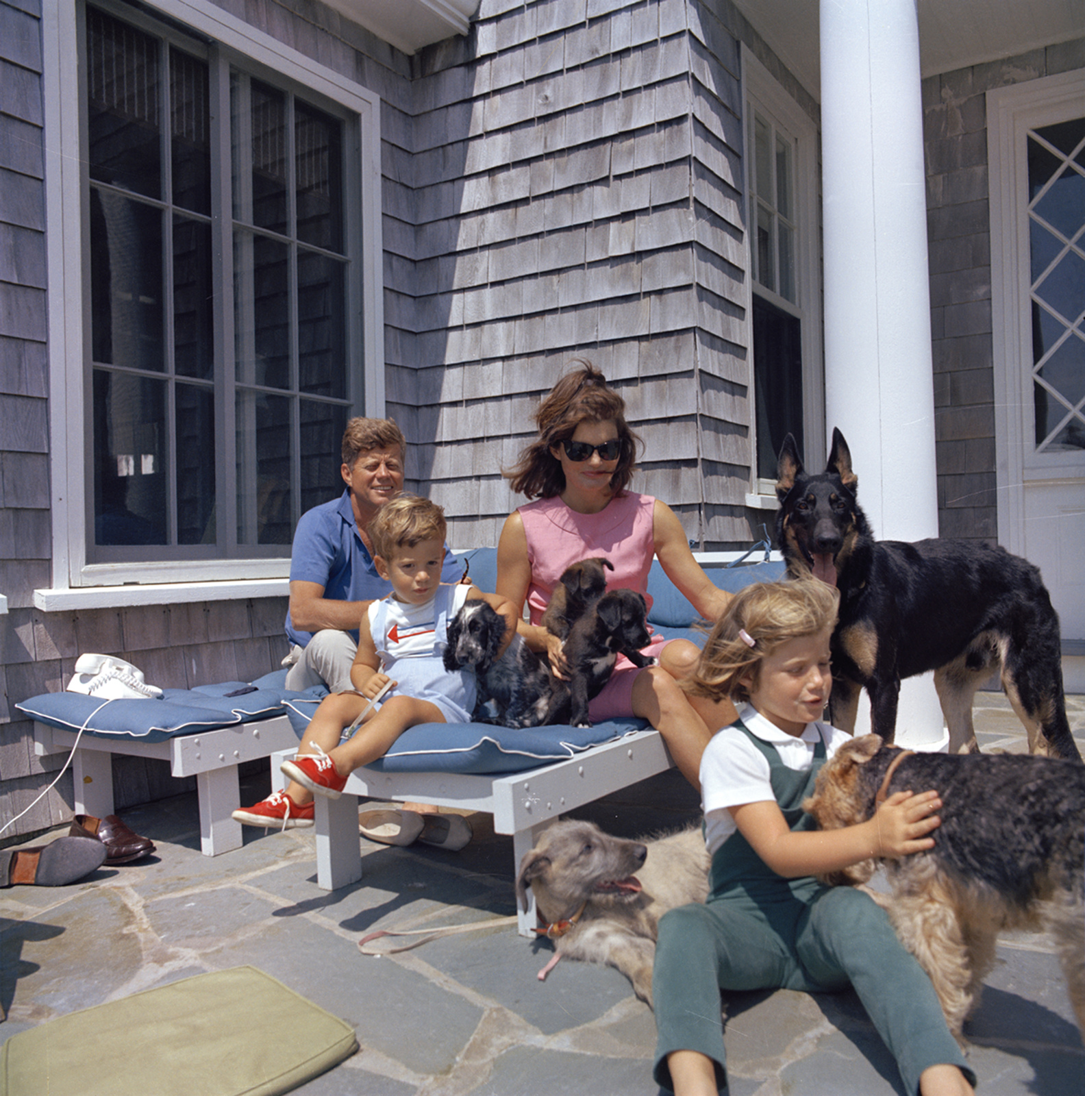 President Kennedy, John F. Kennedy Jr.,  Mrs. Kennedy, and Caroline Kennedy with Family Dogs, Hyannisport, Squaw Island