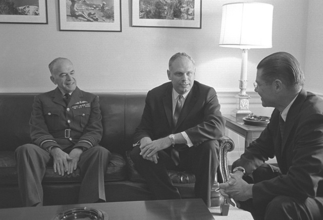 Paul Hellyer, Candian Defense Minister, center, meets with Secretary of Defense Robert S. McNamara, right, at the Pentagon