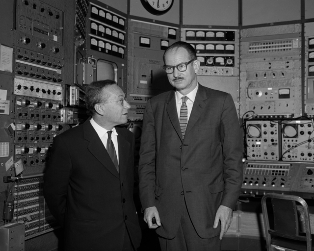 Edwin McMillan (right) and Vladimir Veksler, Russian experimantal physicist (left) in the Bevatron control room, taken October 28, 1963. Morgue 1963-35 (P-2) [Photographer: Donald Cooksey]