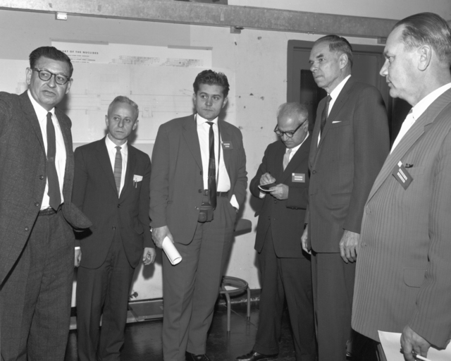 Russian scientists' visit to the Heavy Ion Linear Accelerator. Left to right: Al Ghiorso, Isadore Perlman, A.I. Belov, A.M. Petrosyants, Glenn Seaborg, and G.N. Yakovlev, taken November 21, 1963. Morgue 1963-41 (P-5) [Photographer: Donald Cooksey]