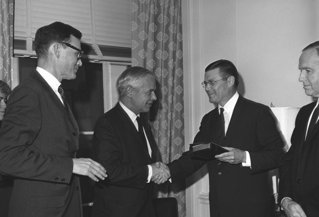 Secretary of Defense Robert S. McNamara, (third from left) congratulates Paul H. Nitze after he was sworn in as Secretary of the Navy and William P. Bundy, left, newly sworn in as Deputy Assistant Secretary of Defense, International Security Affairs. Standing at right is Roswell L. Gilpatrick, Deputy Secretary of Defense
