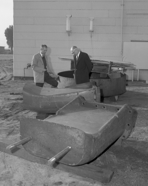 Harvey White, head of the Lawrence Hall of Science project, and his assistant Jim Murphy, looking at the old 37-inch cyclotron magnet, returned from UCLA. Photo taken December 16, 1963. Morgue 1963-55 (P-1) [Photographer: Donald Cooksey]