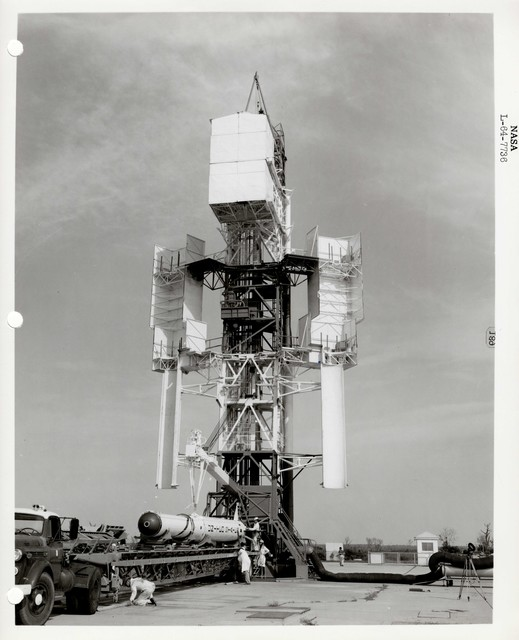 Photograph of a Rocket being Lifted to be Prepared for Launch on a Structure at the Wallops Island Launch Area in Virginia