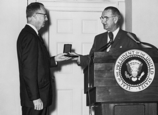 Luis Alvarez receives the 1963 National Medal of Science from President Johnson, taken January 13, 1964. Morgue 1964-13 (P-4) [Photographer: Donald Cooksey]