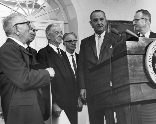 Luis Alvarez (right) receives the 1963 National Medal of Science from President Johnson, taken January 13, 1964. Morgue 1964-13 (P-2). Copy negative from Luis Alvarez print [photographer unknown]