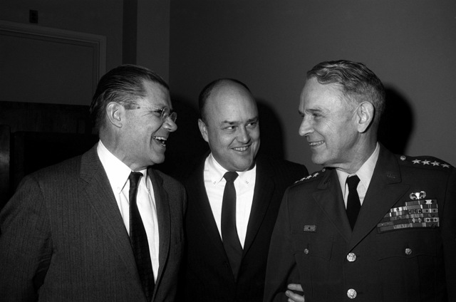 Secretary of Defense Robert S. McNamara, left, talks with Rep. Melvin R. Laird (R-Wis) and GEN. Maxwell D. Taylor, USA, Chairman, Joint Chiefs of STAFF, right, prior to a meeting with the House Committee on Defense Appropriations at the Capitol