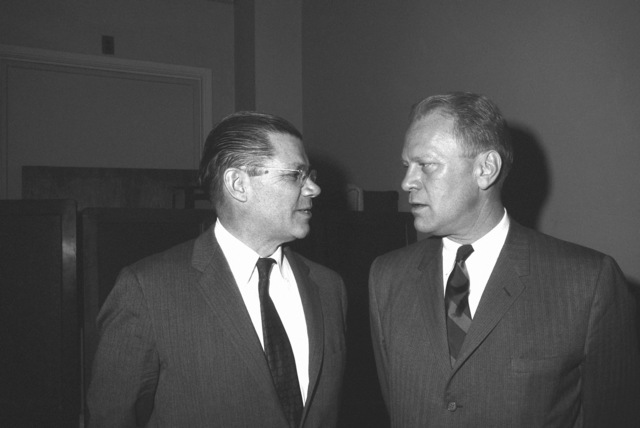 Secretary of Defense Robert S. McNamara, left, talks with Representative Gerald R. Ford (R-Michigan) prior to a meeting with the House Committee on Defense Appropriations at the Capitol