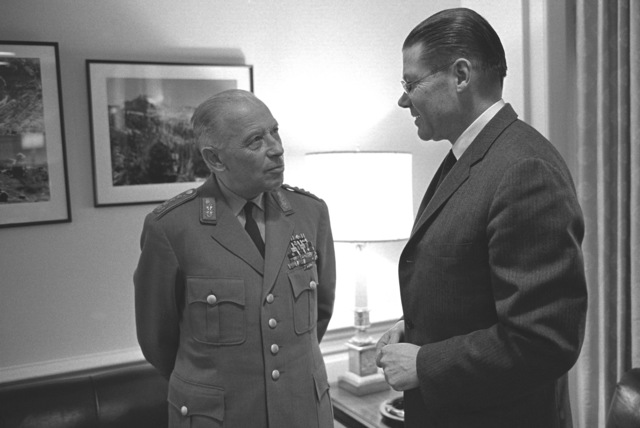 Halvard Lange, Foreign Minister of Norway, visits Secretary of Defense Robert S. McNamara, right, at the Pentagon