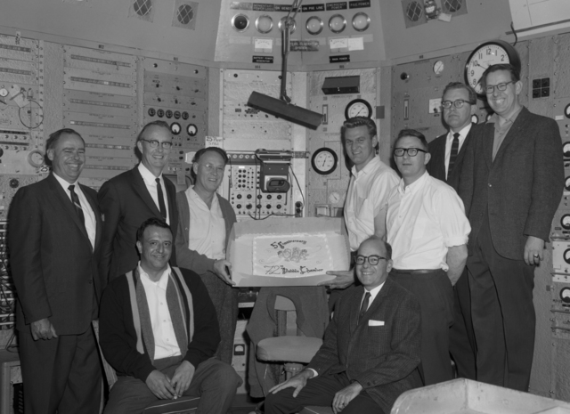 Fifth anniversary of the operation of the Bubble Chamber. Left to right (standing): Jim Shand, Luis Alvarez, Bob Watt, Glen Eckman, Dick Blumberg, Duane Norgren, Rob Smits. Frank Barrera, and Paul Hernandez (seated). Photo taken March 24, 1964. Morgue 1964-14 (P-1) [Photographer: Donald Cooksey]