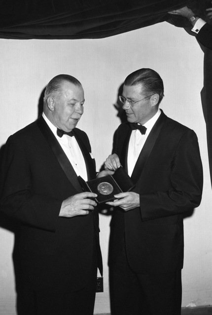 Secretary of Defense Robert S. McNamara, right, is presented the National Security Industrial Associations (NSIA) James Forrestal Memorial Award by Mr. John A. Hill, president of Air Reduction Company, Inc., and NSIA's awards chairman. The ceremony is being held at the Sheraton Park Hotel