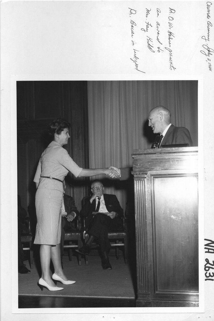 Dr. Oliver W. Hohnes Presents an Award to Mrs. Fay H. Kidd