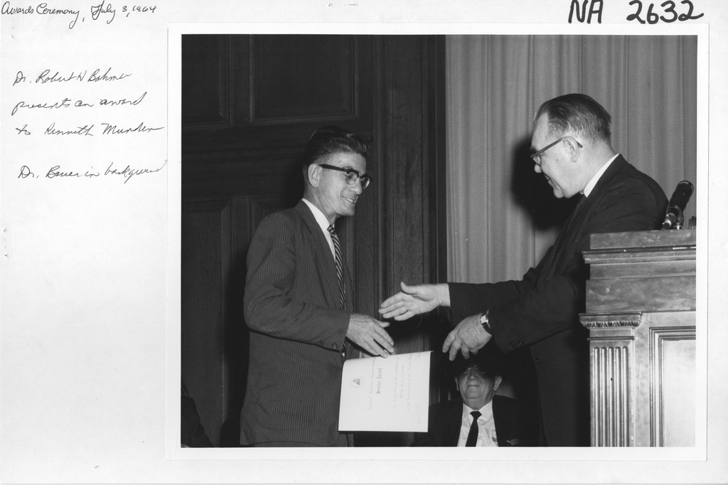 Dr. Robert Bahmer presents an Award to Kenneth W. Munden