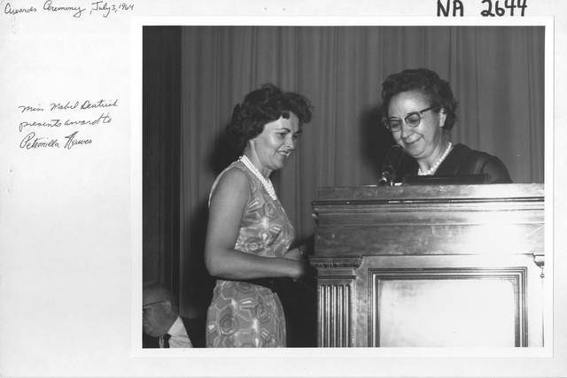 Miss Mabel E. Deutrich Presents an Award to Petronilla Hawes