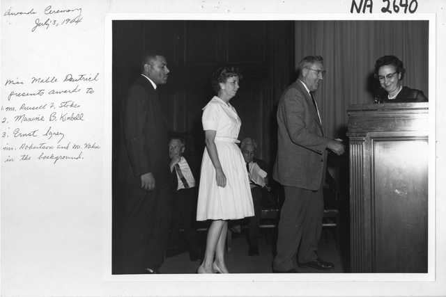Miss Mabel E. Deutrich Presents Awards to Mr. Russell F. Stokes, Maxine B. Kimbell, and Ernest Ignez