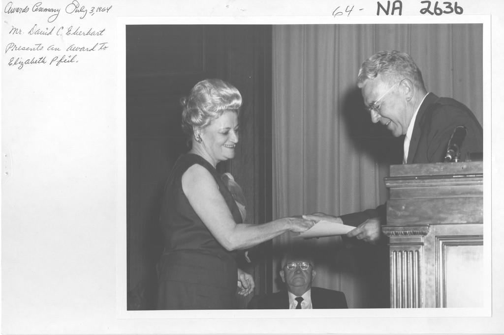 Mr. David C. Eberhart Presents an Award to Elizabeth I. Pfeil
