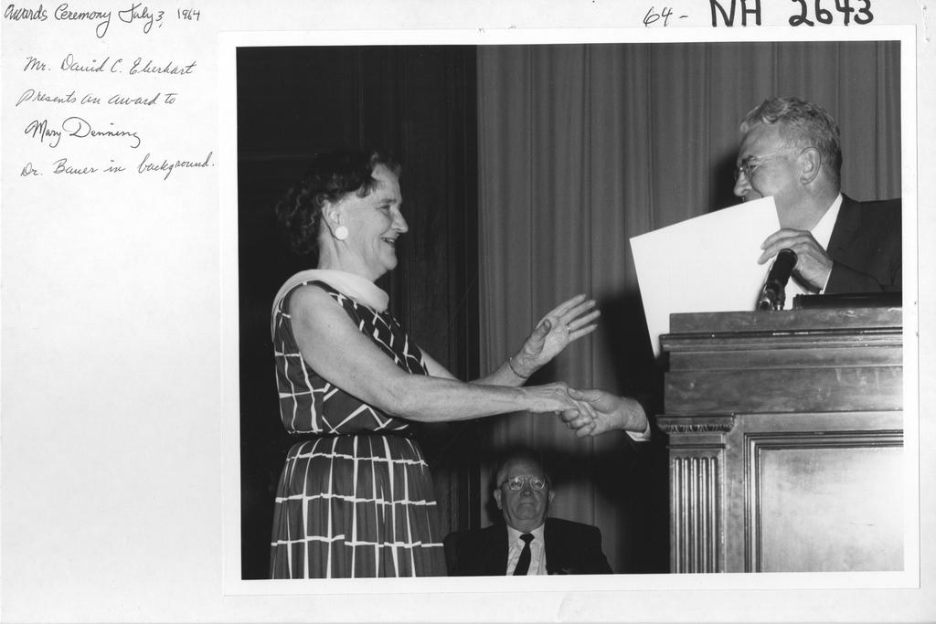 Mr. David C. Eberhart Presents an Award to Mary Denning