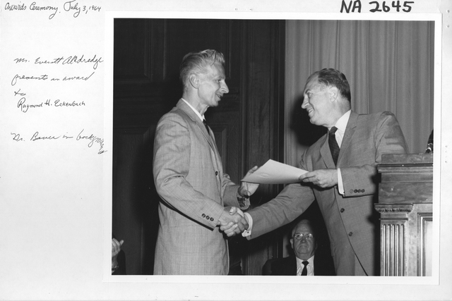 Mr. Everett O. Alldredge Presents an Award to Raymond H. Eckenbach