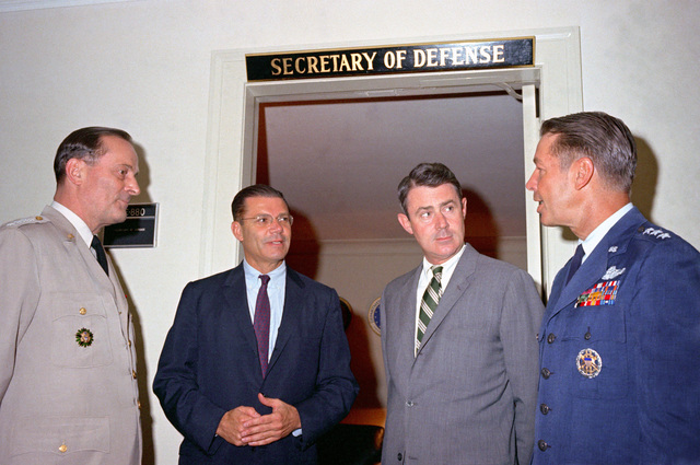 Secretary of Defense Robert S. McNamara holds a spontaneous conference outside his office at the Pentagon. From left to right: General Earle G. Wheeler, USA, chairman, Joint Chiefs of STAFF (JCS); McNamara; Deputy Secretary of Defense Cyrus R. Vance; and Lieutenant General David A. Burchinal, USAF, director of the joint staff, JCS