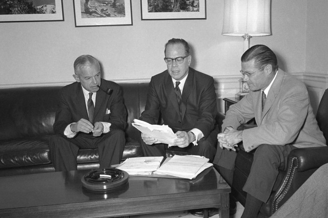 Senator Thomas H. Kuchel (CA), center, meets with Secretary of Defense Robert S. McNamara, right, and Secretary of the Navy Paul H. Nitze at the Pentagon to discuss the future of three US naval shipyards at Hunter's Point, Mare Island, and Long Beach, California