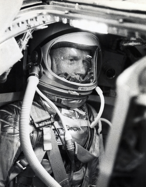 Photograph of John Glenn Seating inside the Mercury Capsule during a Flight Simulation Test