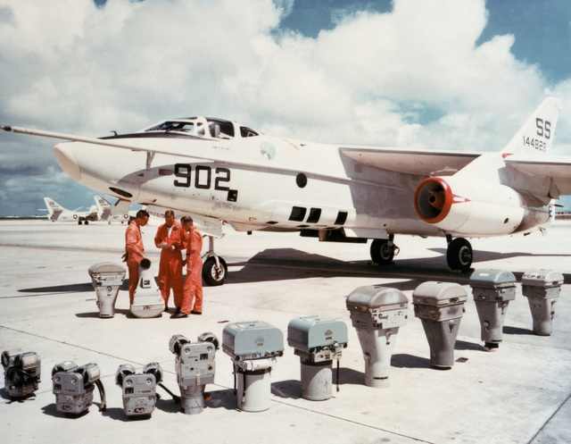 A left front view of an RA-3D Skywarrior aircraft with a display of the camera equipment used aboard it during aerial photographic missions