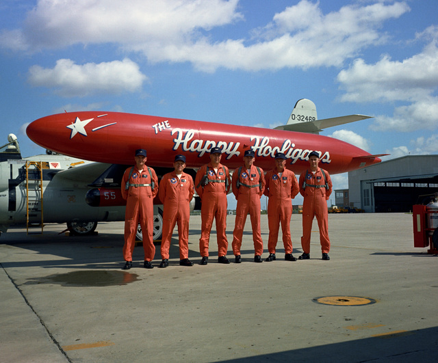 """U.S. Air Force personnel assigned to the 119th Fighter Wing""""Happy Hooligans"""", North Dakota Air National Guard, pose for a photograph standing in front of a F-89D/J Scorpion aircraft at Hector Field, North Dakota. The""""Happy Hooligan""""pilots flew the F-89D/J Scorpion aircraft from 1960-to-1966. (A3604) (U.S. Air Force PHOTO) (Released)"""