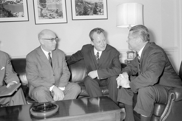 Secretary of Defense Robert S. McNamara (right) meets with Fritz Erler (left), a member of the Social Democratic Party and Deputy Chairman of the Fraktion Executive Committee, the Bundestag, Federal Republic of Germany; and Willey Brandt, Mayor of West Berlin, at the Pentagon