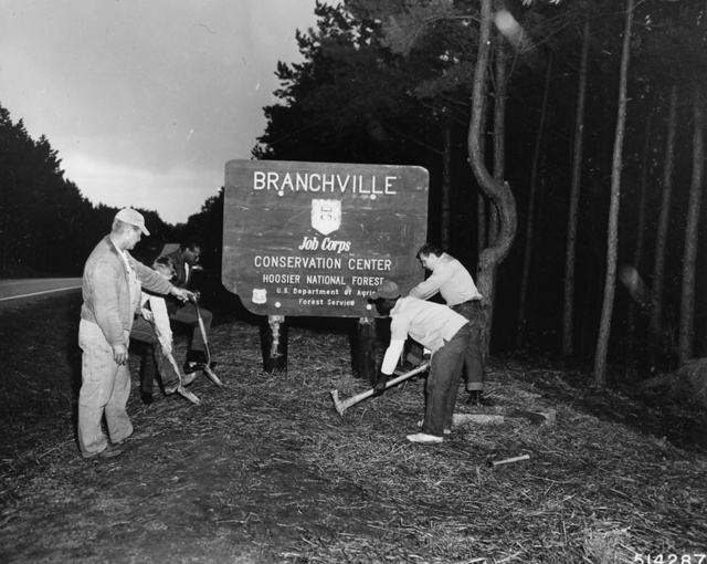 Photograph of Work Supervisor Merle Flamion Instructs Corpsmen of the Branchville Job Corps Center (JCC)