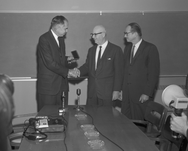 Wallace B. Reynolds receiving the AEC award from Glenn Seaborg, Edwin McMillan at right. Photo taken November 19,1965. Morgue 1965-43 (P-1) [Photographer: Donald Cooksey]