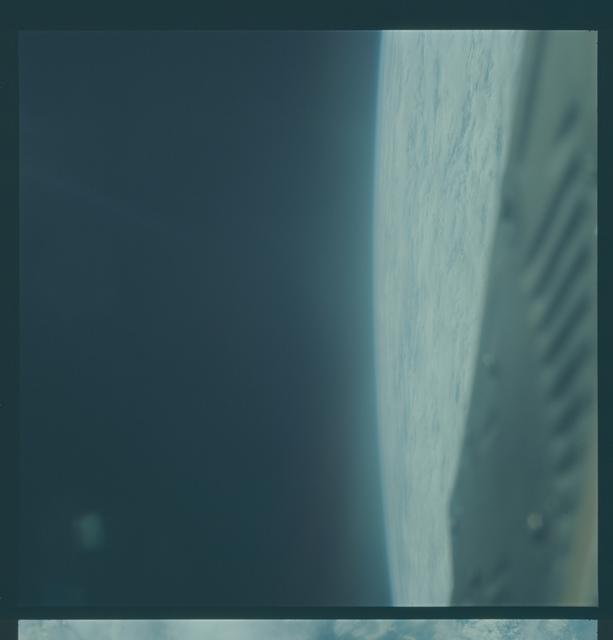 Gemini VI Mission Image - Earth limb, Clouds over sea