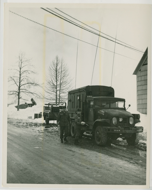 3/64. Fort Wainwright, Alaska. Fort Wainwright signal specialists implement emergency communication in stricken Valdez (10 Mar. 1964)