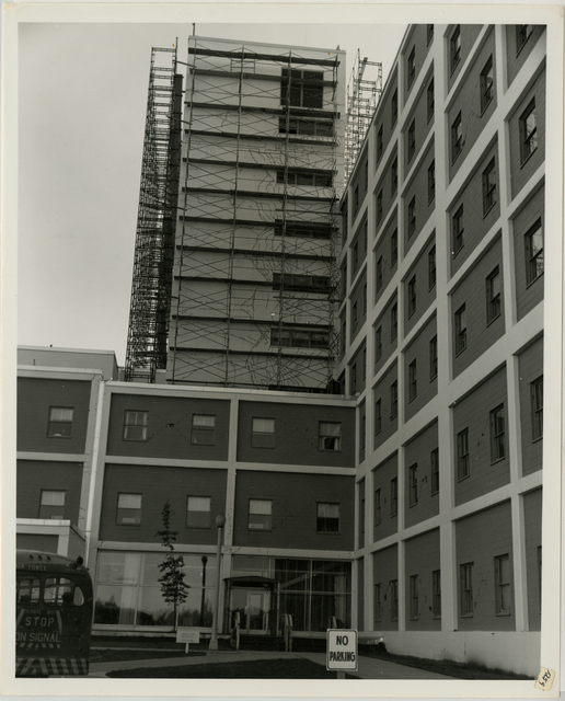 7/64. Anchorage - 5040th Hospital at Elmendorf Air Force Base - Close-up of front entrance - Scaffolding up in preparation of repair to quake damage exterior walls