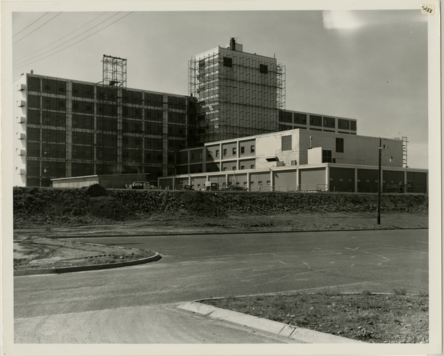 7/64. Anchorage - 5040th Hospital at Elmendorf Air Force Base - Scaffolding up for exterior repairs of quake damage building