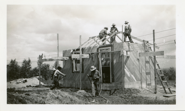 Carpenters Putting up Rafters on Hospital Pump House
