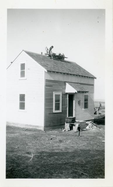 Community Housing Project Construction / Men Working