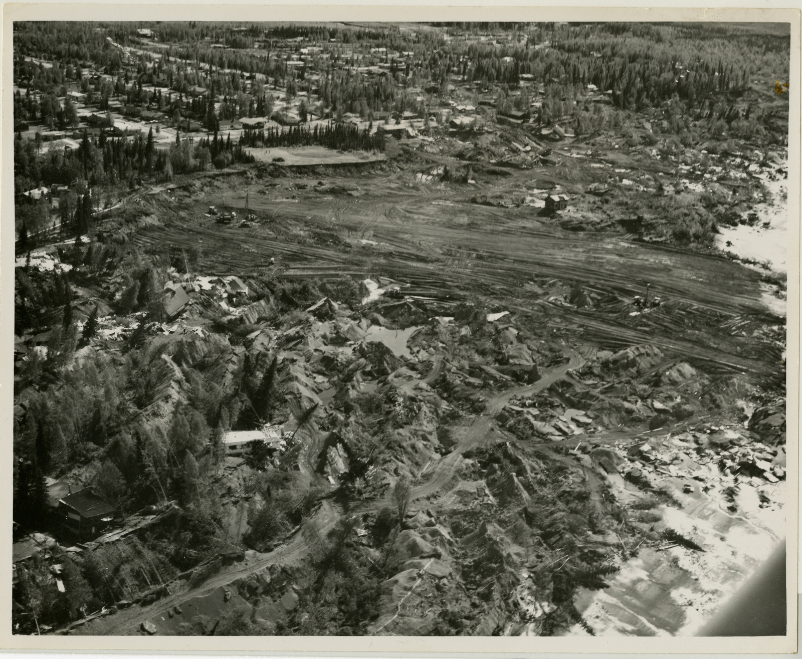 Contract 64-68 Turnagain Debris removal and area grading, Contractor Walsh and Company, 11 June 1964, photo by Tice, looking southwest, vicinity of Lynnary park