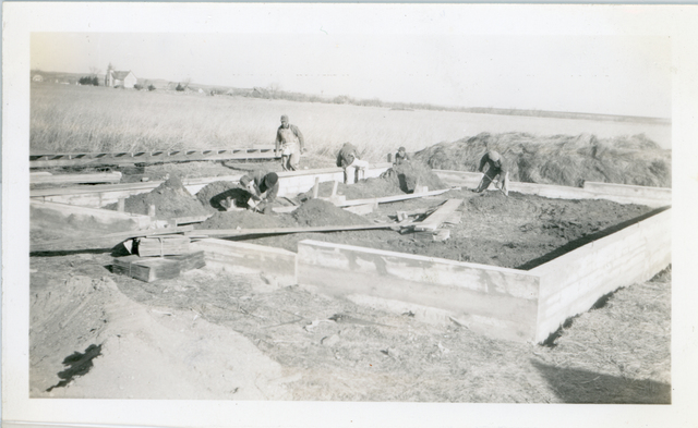 Foundation of Community Housing Project Barn / Men Working